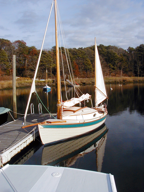 """Beach Point 18 """"WoodWind"""" at the dock in Arey's Pond"""